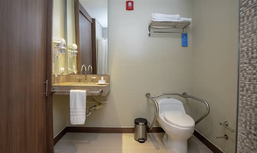 Accessible Guestroom Bathroom with Mirror, Vanity, and Toilet