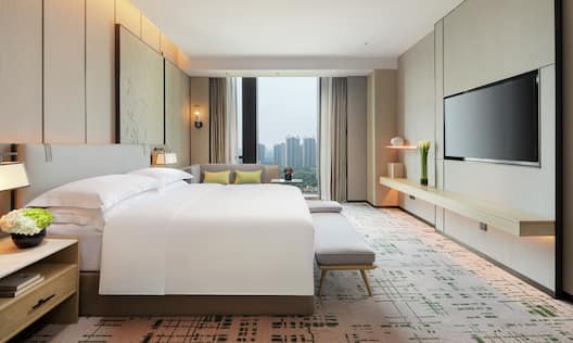 Executive Suite with Bed TV and large Window with City View