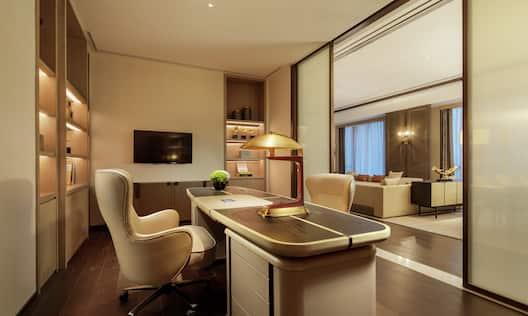 Presidential Suite Desk Area TV and Sofa