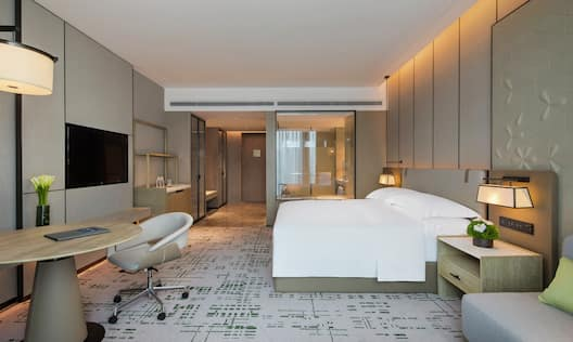 Deluxe King Room with Modern Furnishings and In-wall HDTV