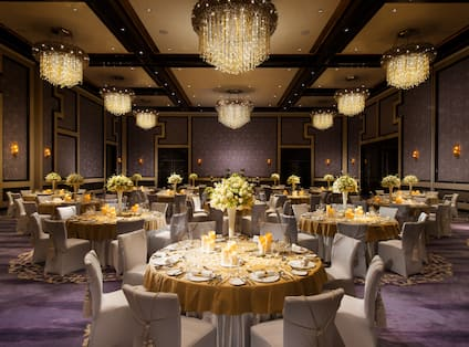 Spacious Grand Ballroom with Round Tables and Chairs