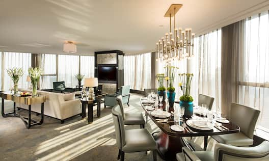 Presidential Suite Lounge Area with Dining Table, Chairs, Sofa and Wall Mounted HDTV