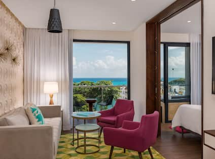 Guest Living Room with Sofa, Small Coffee Table, Armchairs and Outside Balcony