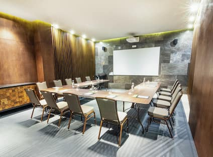 Table and Chairs in U-Shape Setup in Meeting Room