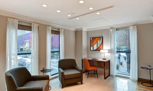 Suite Living Area with Two Armchairs and Desk Area