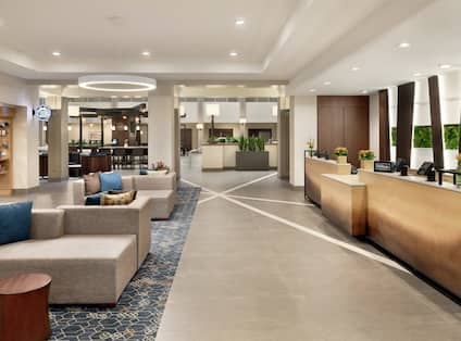 Embassy Suites Front Desk, Lounge Area, and Room Technology