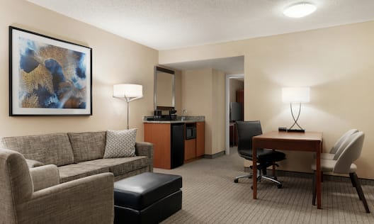 King Suite with Couch, Footrest, Work Desk, and Mirror