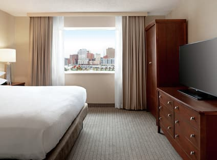 Premium King Suite with Bed, Room Technology, and Outside View