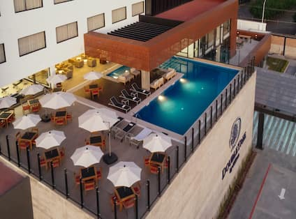 Exterior of hotel with rooftop pool