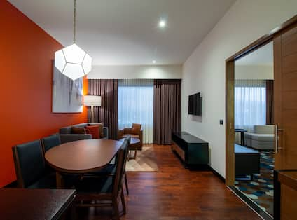 Suite area in room with seating area and table