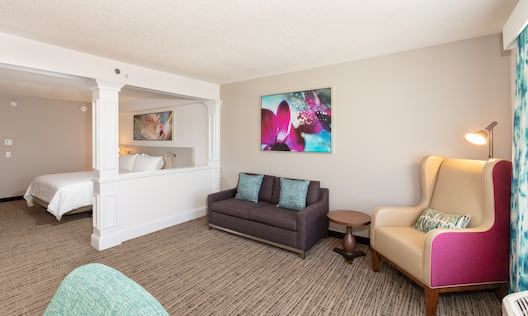 Suite Living Area and View  of Bedroom with Large Bed