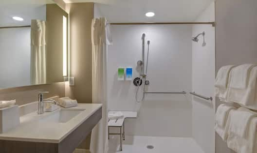 guest bathroom with roll in shower