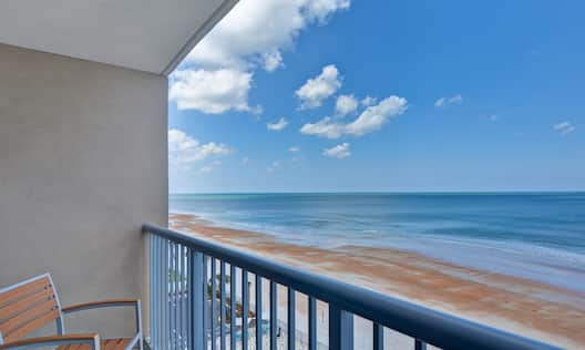 guest room balcony with beachfront view of ocean