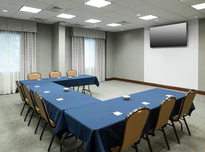 Meeting Room with U-Shape Table Layout and Wall Mounted TV