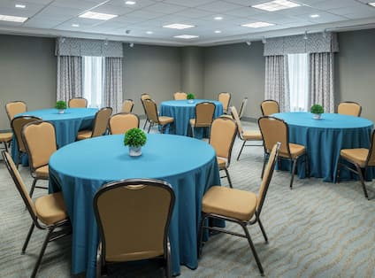 Meeting Room with Roundtables and Chairs