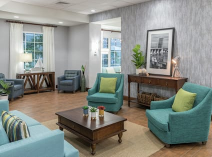 Lobby Seating Area with Armchairs, Sofa and Coffee Table