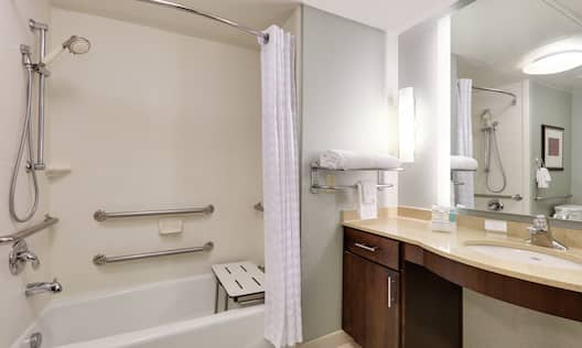 ADA Bathtub with Seat and Grab Bars