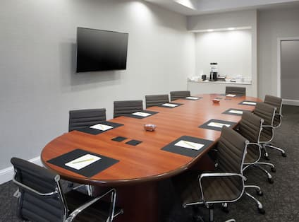 Boardroom Table And Wall Mounted TV