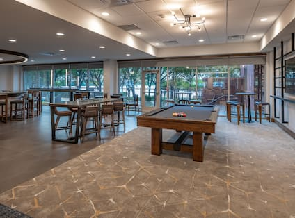 Pool Table and Lounge Seating in Game Room
