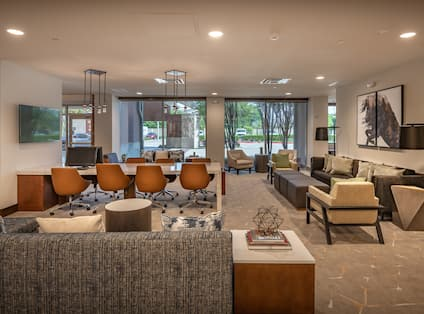 Business Center With Lounge Seating and TV