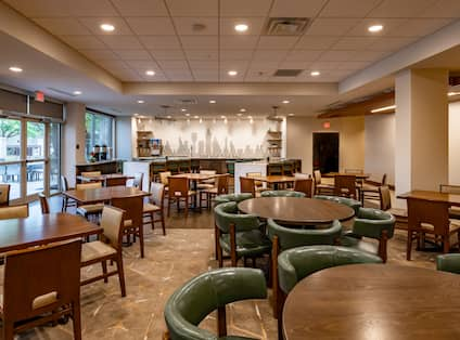 Tables, Chairs and View of Food Service Area in Urban Mustang Restaurant