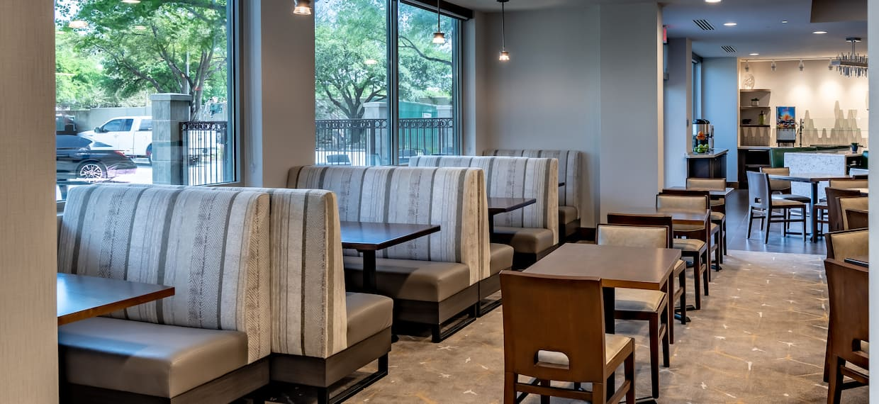 Booth Seating by Large Windows, Tables, and Chairs in Urban Mustang Restaurant Seating