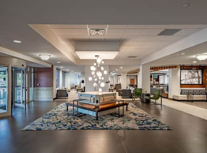 Glass Entry Doors and Sitting Area in Lobby