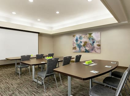 Meeting Room with Classroom Setup and Projection Screen