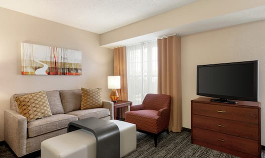 King Studio Suite Living Area with TV