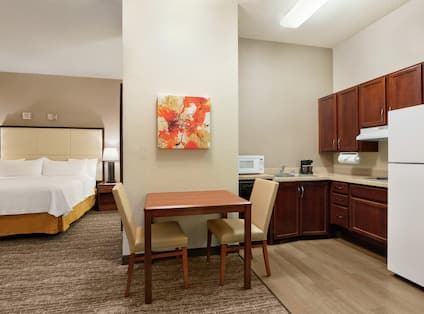 Accessible Suite with King Bed, Dining Table, and Kitchen