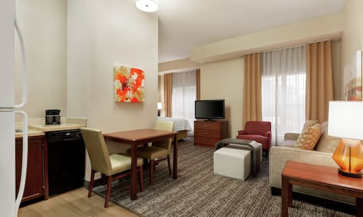 Accessible Suite with Kitchen, Dining Table, and Lounge Area