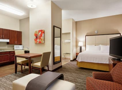 Accessible Suite with King Bed, Lounge Area, Dining Table, and Kitchen