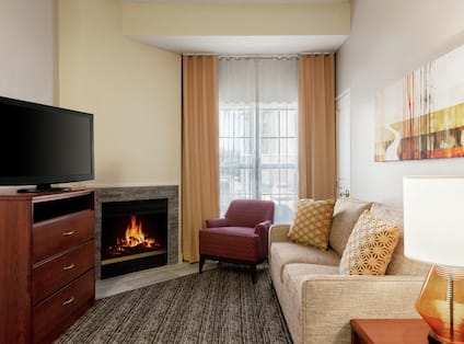 Accessible Suite Lounge Area with Fireplace and TV