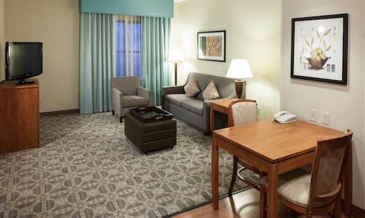 Suite Living Area with Lounge Seating, Television and Table and Chairs