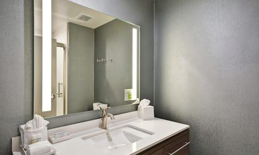 Guestroom Bathroom with Mirror and Vanity