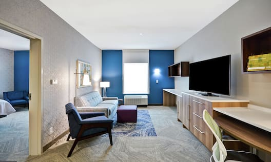 King Guestroom Suite with Lounge Area, Work Desk, and Room Technology