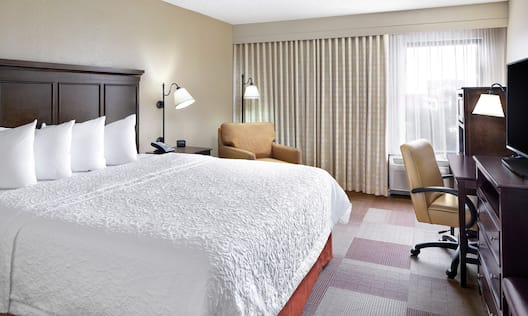 King Bed, Work Desk, and Chairs in Guest Room