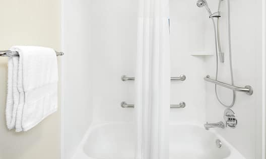 Accessible Shower and Bathtub with Grab Bars and Handheld Showerhead in Guest Room Bathroom