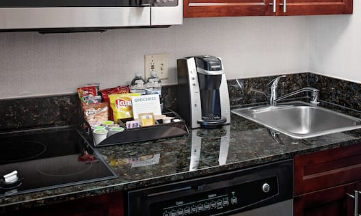 Guestroom kitchen area coffee making station with snacks