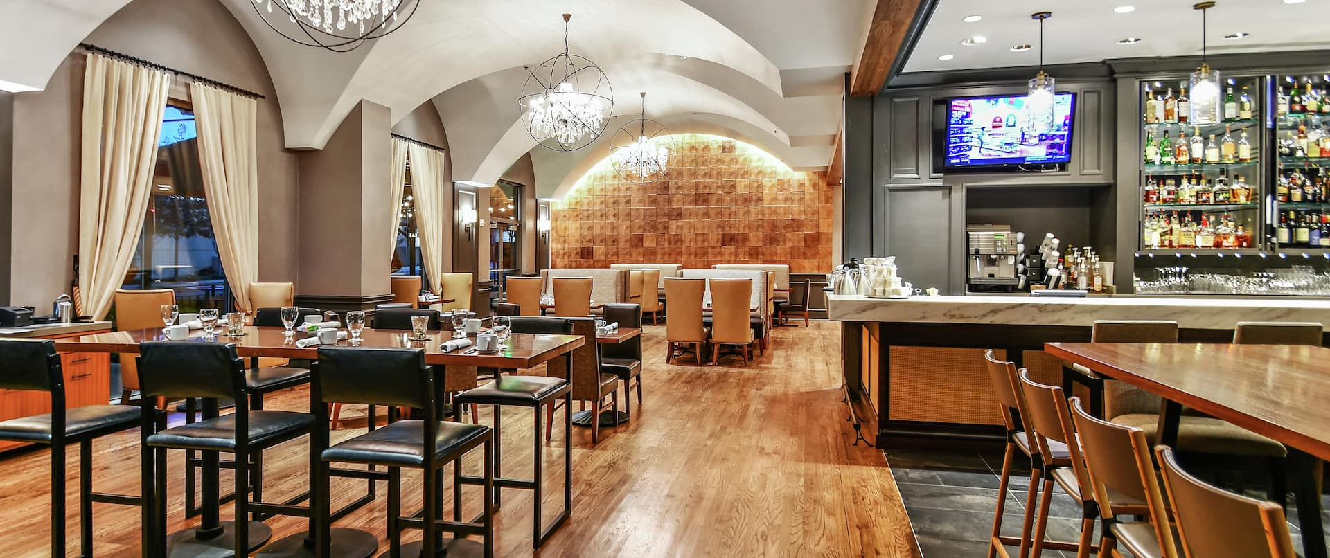 Dining Tables, Chairs, and Bar Seating in Grain Restaurant & Woodbine Bar