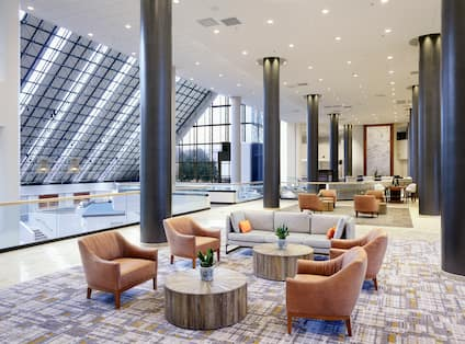 Lobby Seating Area with Armchairs, Sofa and Tables