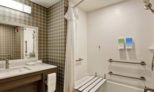 Accessible Bathroom With Tub and Shower Seat