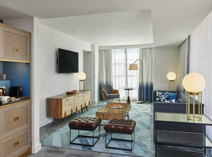 Corner Suite Living Area with Sofa, Coffee Table, Lounge Chair and Television