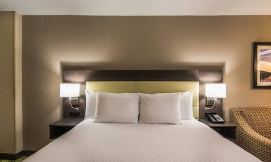 One King Bed with Bedside Lamps in Guestroom