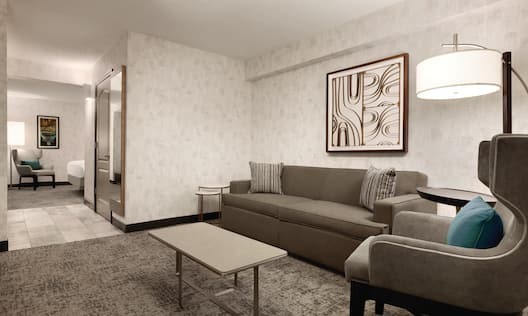 Suite Living Room with Lounge Seating and Entry to Bedroom