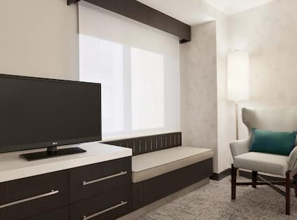 Guestroom with Television and Chair