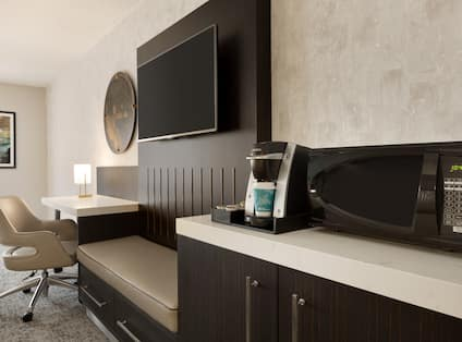 Guestroom with Microwave, Coffee Maker, Television and Work Desk