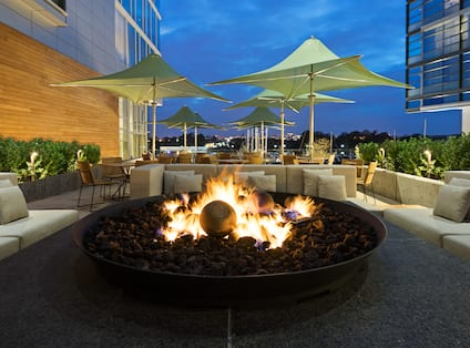 Outdoor Patio with Firepit and Seating at Night
