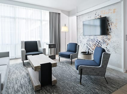 Guest Suite Living Room with Sofa, Armchairs and Wall Mounted HDTV