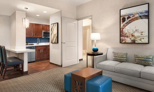 Suite Living Room with Couch, Kitchen and Entry to Bedroom